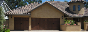 Wood carriage garage door with hardware
