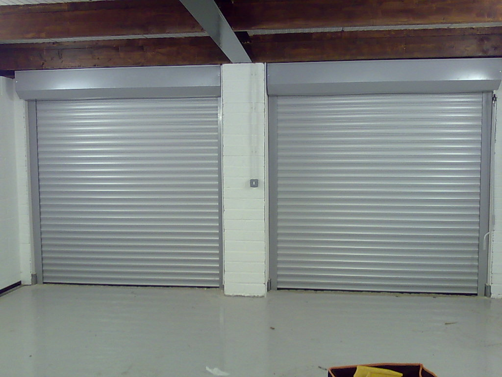 Doors To Garage: A Secret Tip To Fix A Dented Aluminum Garage Door