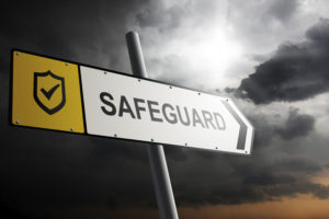 Safeguard direction. Yellow traffic sign with cloudy sky in the background.