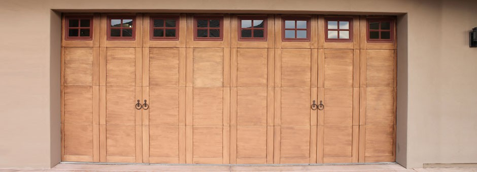 Wood garage door with windows and decor hardware