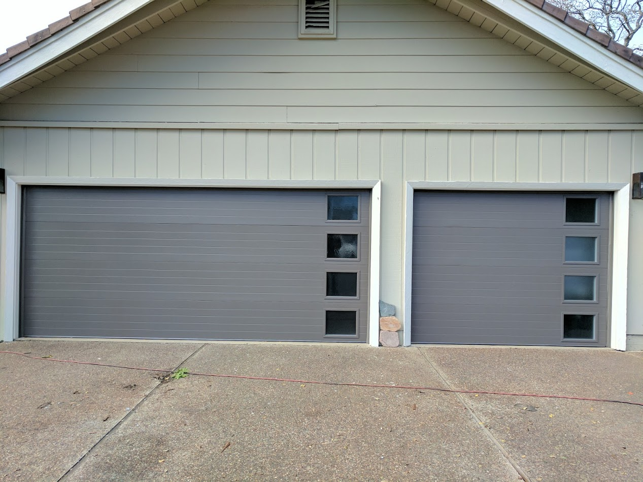 Modern garage door installation with side windows for Clopay steel garage doors